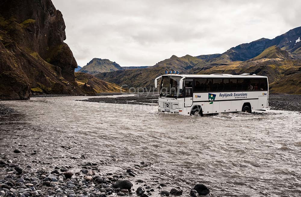 Iceland, bus crossing river. For editorial use only.